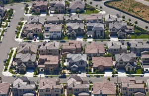 The median price of an Orange County home – or the price at the mid-point of all sales – was $615,000, down $14,500 from June's pricing. Sales totaled 3,692 last month, 139 fewer than in June. Still prices and sales were at eight- to 10-year highes for the month of July, CoreLogic figures show. ///ADDITIONAL INFO / / / aerials shot 080510 JEBB HARRIS, THE ORANGE COUNTY REGISTER - Recently constructed homes sit on the site of the former Tustin Marine Corps Air Station in this August 5, 2010 aerial photo. - aerial photos shot August 5, 2010 including: JWA terminal const. & takeoffs. John Wayne Airport, Tustin base development & The District. Generic housing trends art, construction mortgage sales development, El Toro, The great park, balloon, tower, blimp hangars, UCI campus views, Dredging in back bay, Stalled HB beachfront hotel development, Pacific city, condos, shopping, HB offshore oil platform, Huntington Beach surf tournament beach scene, OC Fairgrounds , Orange County Fair.